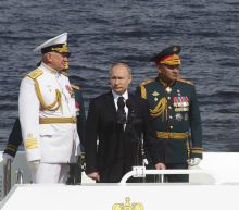 9b1747097 Putin leads Russian naval parade after crackdown in Moscow