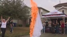 Woman torches her own wedding dress after escaping an abusive marriage