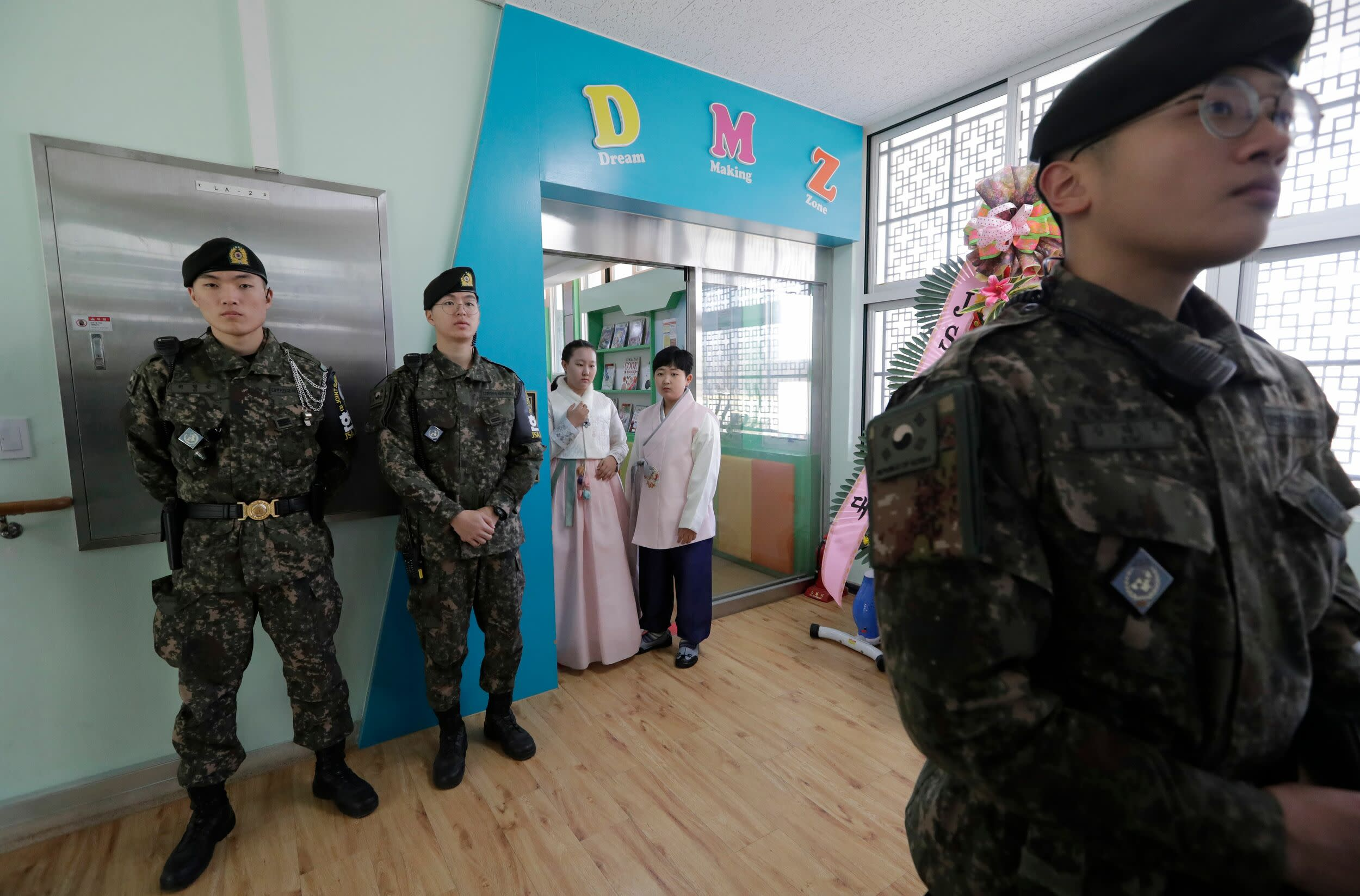 Elementary school Graduates wait to attend a graduation ceremony at Taesungdong freedom village inside the demilitarized zone between North and South Korea, near the border village of Panmunjom in Paju on January 11, 2019. (Photo by Lee Jin-man / POOL / AFP)        (Photo credit should read LEE JIN-MAN/AFP/Getty Images)