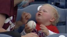 Look at this Phillies baseball baby attempt to eat a home run baseball