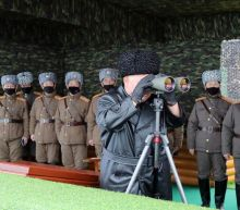 Kim warns of 'serious consequences' if virus reaches North Korea