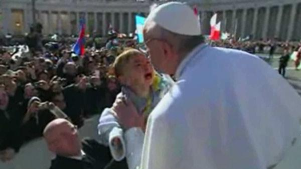 Pope Francis kisses crying baby