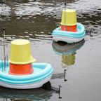 IKEA's super-sized bath toys collect trash on the water