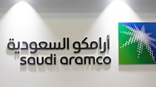 WRAPUP 2-Saudi Aramco aims to buy Reliance stake, reports lower earnings