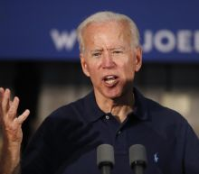 The Latest: Biden offers health plan 'public option' details