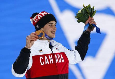 Bronze medalist Mark McMorris of Canada celebrates during the medal ceremony for the men's snowboard slopestyle competition in the Olympic Plaza at the 2014 Sochi Olympic Games