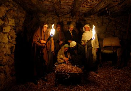 FILE PHOTO: Israeli Arabs perform a nativity scene for tourists in the northern town of Nazareth December 22, 2008. REUTERS/Baz Ratner/File Photo