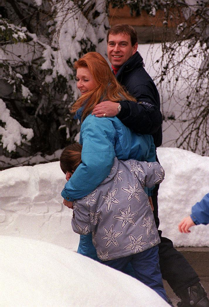 The Duke of York with his arm round the Duchess of York with Princess Eugenie, after the Duke joined the Duchess of York and their two children Princesses Eugenie and Beatrice in the Swiss ski resort of Verbier to celebrate his 39th birthday (19/2/99).