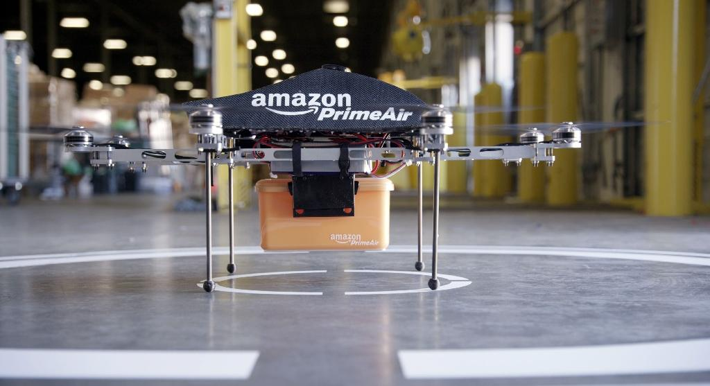 "This undated photo released by Amazon on December 1, 2013 shows an ""octocopter"" mini-drone that would be used to fly small packages to consumers (AFP Photo/)"