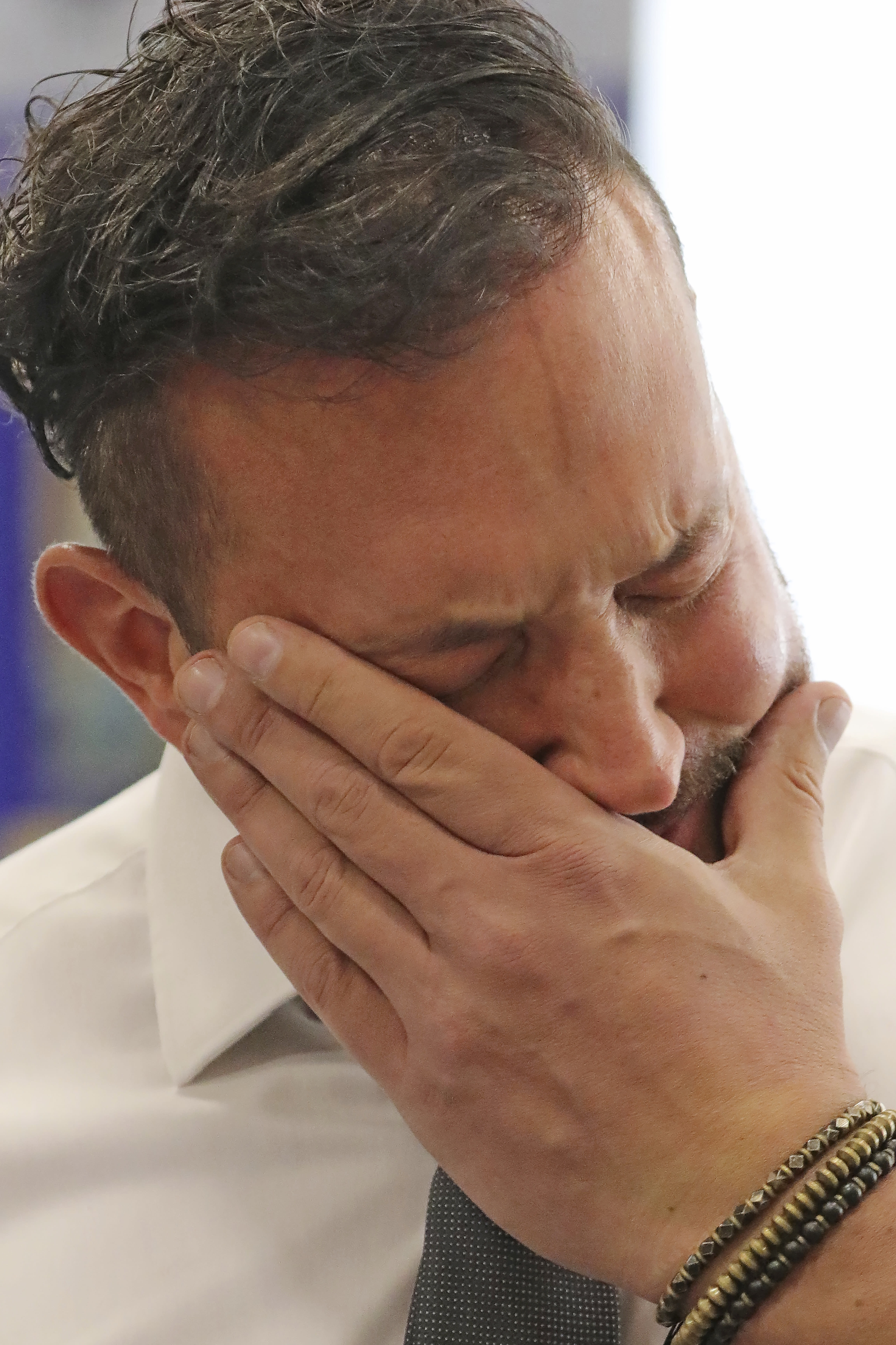 """FILE - In this Sept. 26, 2019, file photo, Justin Utley fights back his emotions as he remembers conversion therapy following a hearing in Salt Lake City. The Church of Jesus of Christ of Latter-day Saints is opposing a proposed ban on conversion therapy in Utah, just months after it said it wouldn't stand in the way of a similar rule under consideration. The church said in a statement posted Tuesday, Oct. 15, 2019, night that the regulatory rule prohibiting Utah psychologists from engaging in LBGTQ conversion therapy with minors would fail to safeguard """"religious beliefs"""" and doesn't account for """"important realities of gender identity in the development of children."""" (AP Photo/Rick Bowmer, File)"""