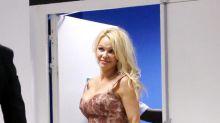 Pamela Anderson Legit Wore Metallic Stilettos to a Soccer Match