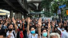 Hundreds defy Thai crackdown after emergency decree, arrests