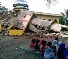 Indonesia quake toll jumps to 97 as more bodies found in rubble