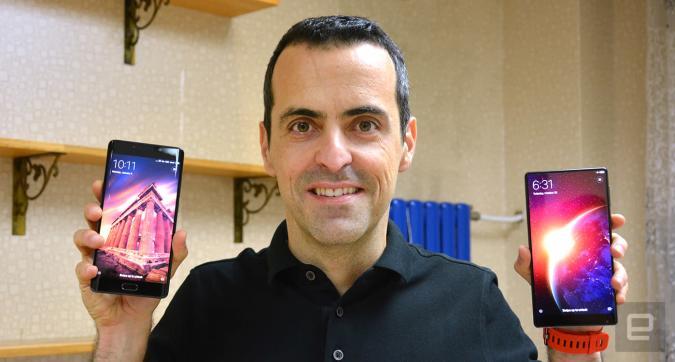 Xiaomi's Global VP Hugo Barra holding a Mi Note 2 and a Mi MIX.