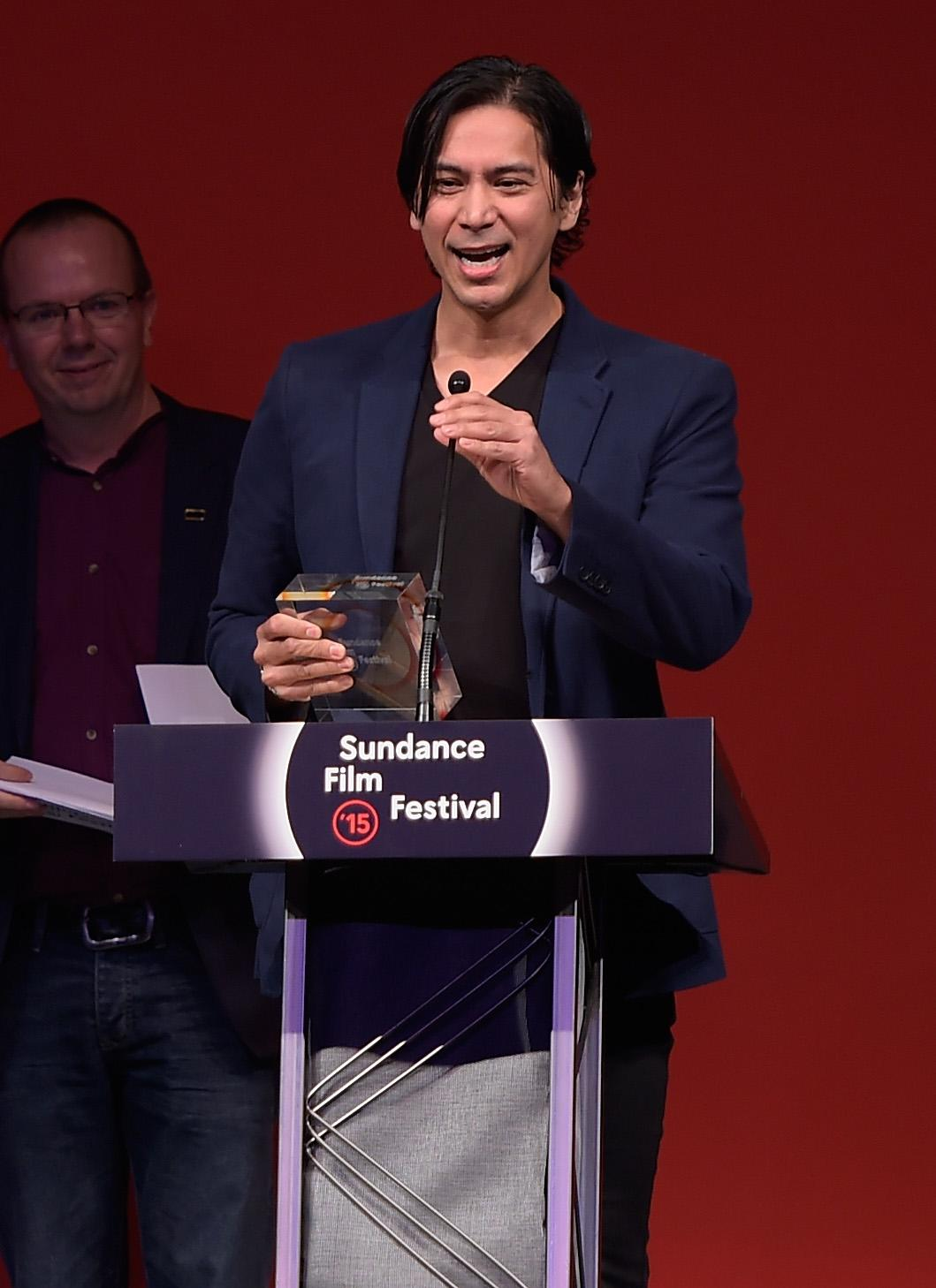 "Kalani Queypo of ""Slow West"" accepts the World Cinema Grand Jury Prize, on behalf of director John Maclean at the Awards Night Ceremony of the 2015 Sundance Film Festival on January 31, 2015 in Park City, Utah (AFP Photo/Michael Loccisano)"