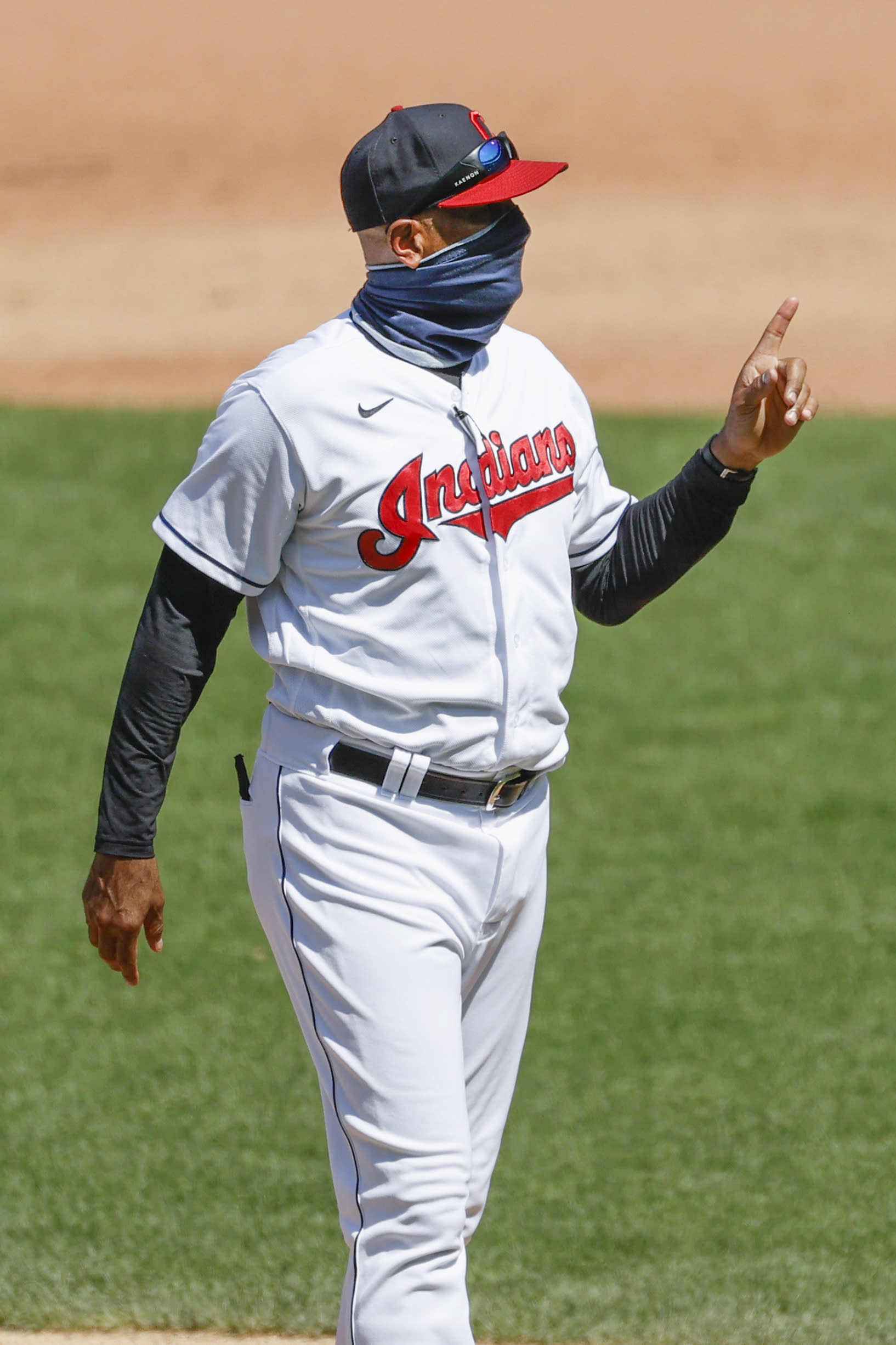 Cleveland Indians acting manager Sandy Alomar Jr. walks back to the dugout after making a pitching change against the Detroit Tigers during the fourth inning of a baseball game, Sunday, Aug. 23, 2020, in Cleveland. (AP Photo/Ron Schwane)