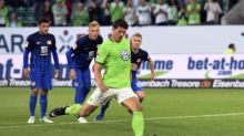 Gomez penalty gives Wolfsburg edge in relegation playoff