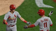 Cardinals return to action postponed after another positive coronavirus test