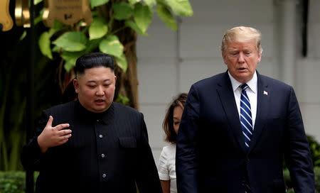FILE PHOTO: North Korea's leader Kim Jong Un and U.S. President Donald Trump talk in the garden of the Metropole hotel during the second North Korea-U.S. summit in Hanoi, Vietnam February 28, 2019. REUTERS/Leah Millis/File Photo