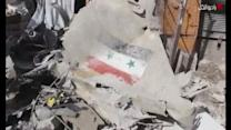 Syrian army fighter jet crashes into market, killing 27