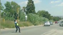 Dancing traffic warden dazzles drivers