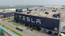 Tesla posts record $1.1bn profit but warns of chip shortage