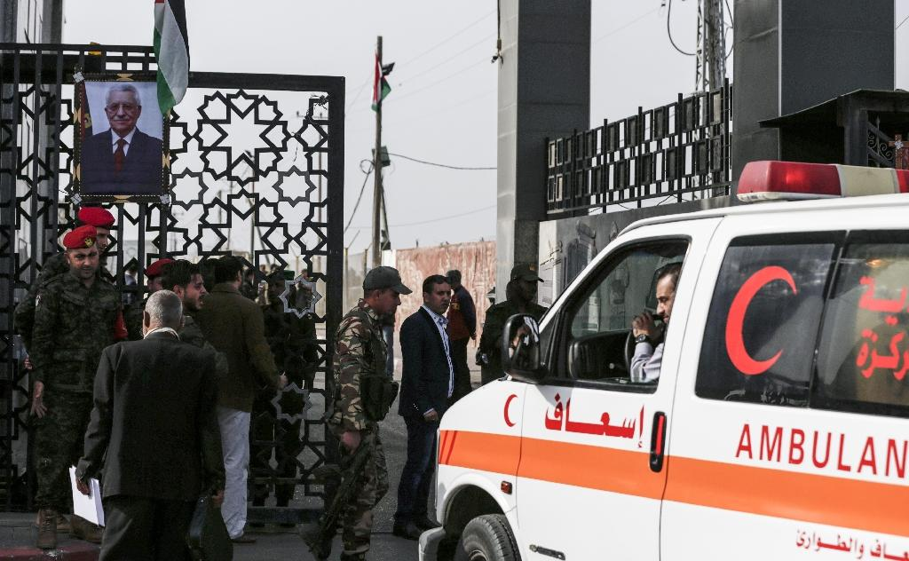 This file photo taken on November 18, 2017 shows an ambulance waiting to cross the Rafah border crossing with Egypt in the Gaza strip