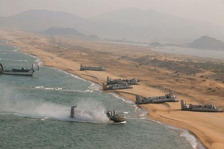 Landing and anti-landing exercises at an unknown location. REUTERS/KCNA