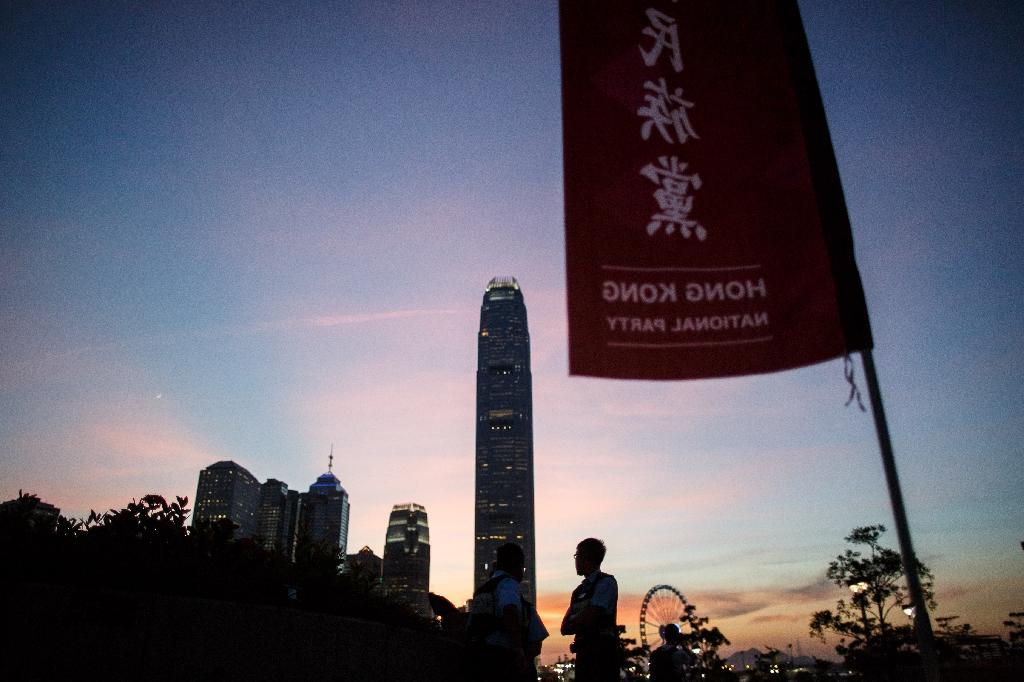 The momentum behind new young activists calling for a complete break from China running for office could draw support away from more established pro-democracy parties, such as the Hong Kong National Party, effectively splitting the vote (AFP Photo/Anthony Wallace)