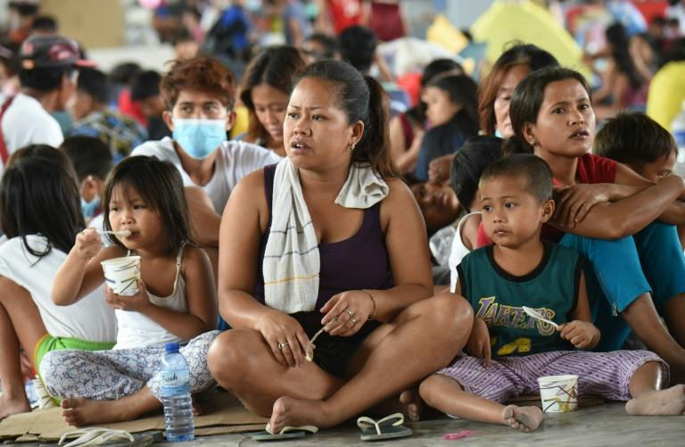 Families have taken refuge in evacuation centres, unsure of when they will be able to return to their homes (AFP Photo/Ted ALJIBE)