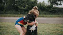 Children who grow up with a dog 'are better behaved', new research suggests