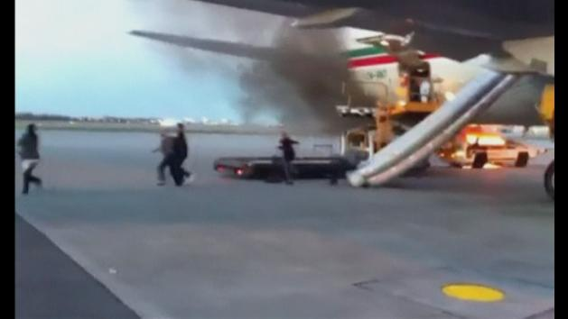 Fire on tarmac sends passengers running from plane