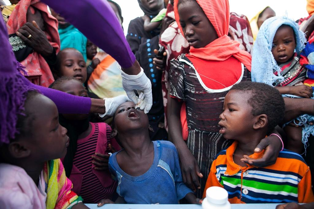 Polio is easily prevented through a vaccine, but there is no cure. Transmitted from person-to-person, often through faeces, it mainly affects children under five (AFP Photo/Albert Gonzalez Farran)