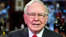 Buffett upbeat on American business; Berkshire operating profit down