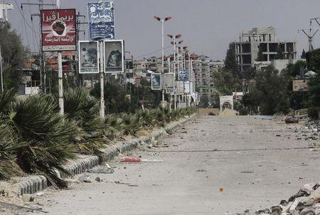 A view shows deserted street targeted by snipers loyal to Syria's President Assad in the Damascus suburb of Harasta