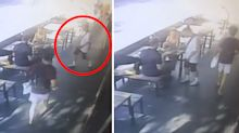 Daylight rib-ery! Diners left baffled by passer-by's brazen act