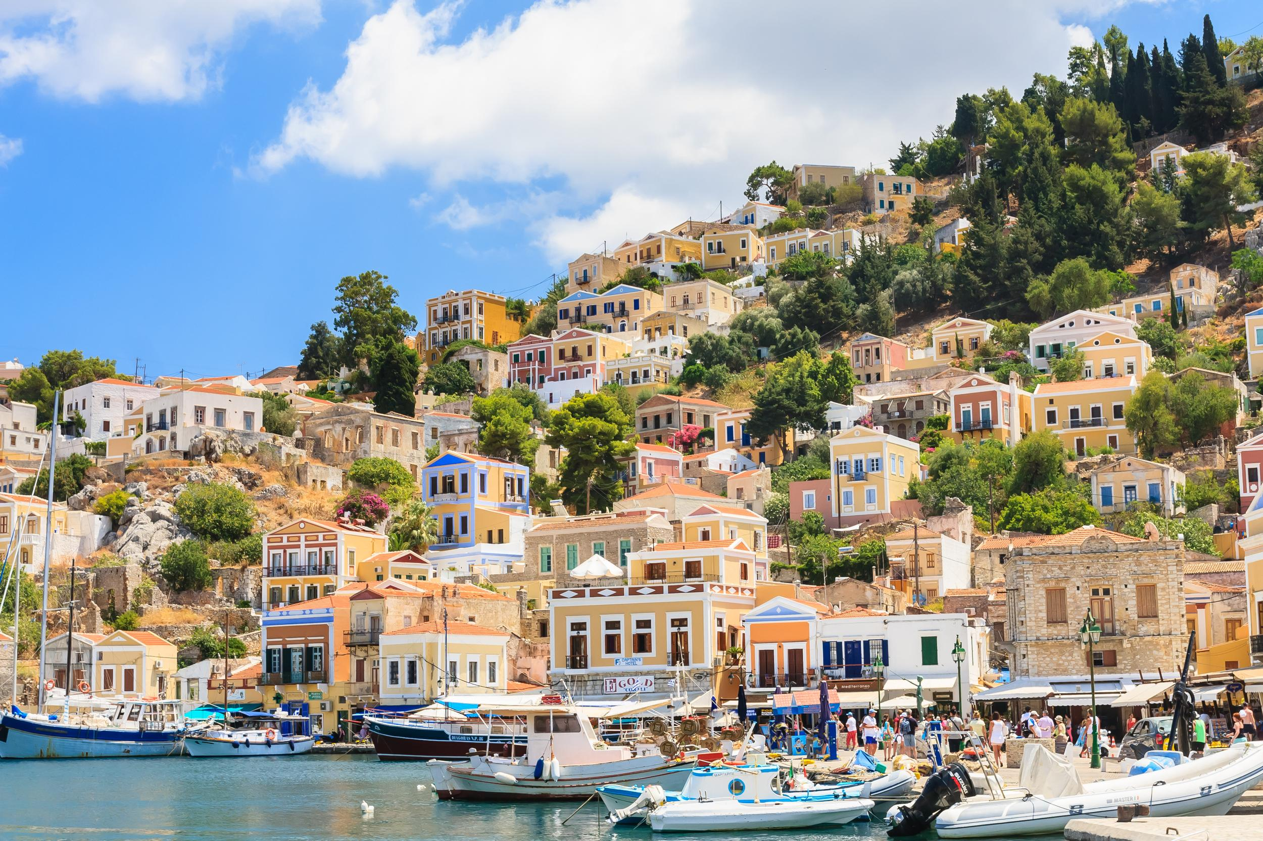 """<p>With one of the prettiest harbours in Greece, Symi is a picturesque island boasting impeccable architecture, cafes, restaurants and a slow pace of life, unlike its neighbour <a href=""""http://travel.aol.co.uk/guides/rhodes/"""" target=""""_blank"""">Rhodes</a>. Ideal for a lazy holiday, Symi has wonderful tavernas by the sea, serving up its famous shrimps, and there is no lack of beaches on the island. Many of the sandy and pebbly beaches are off the beaten track and only reachable by taxi. Some of the best places to visit on the island include the monastery of the Archangel Michael Panormitis, scenic village Pedi and Kali Strata, the stony stairway of 500 steps which lead to the upper part of Chorio town.</p>"""