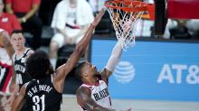 Damian Lillard, Blazers survive thriller against Nets to clinch spot in Western Conference play-in series