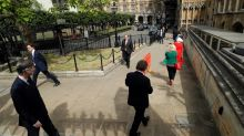 UK lawmakers queue around parliamentary palace to cast votes