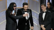 The awkward moment James Franco mic-blocks Tommy Wiseau at the Golden Globes