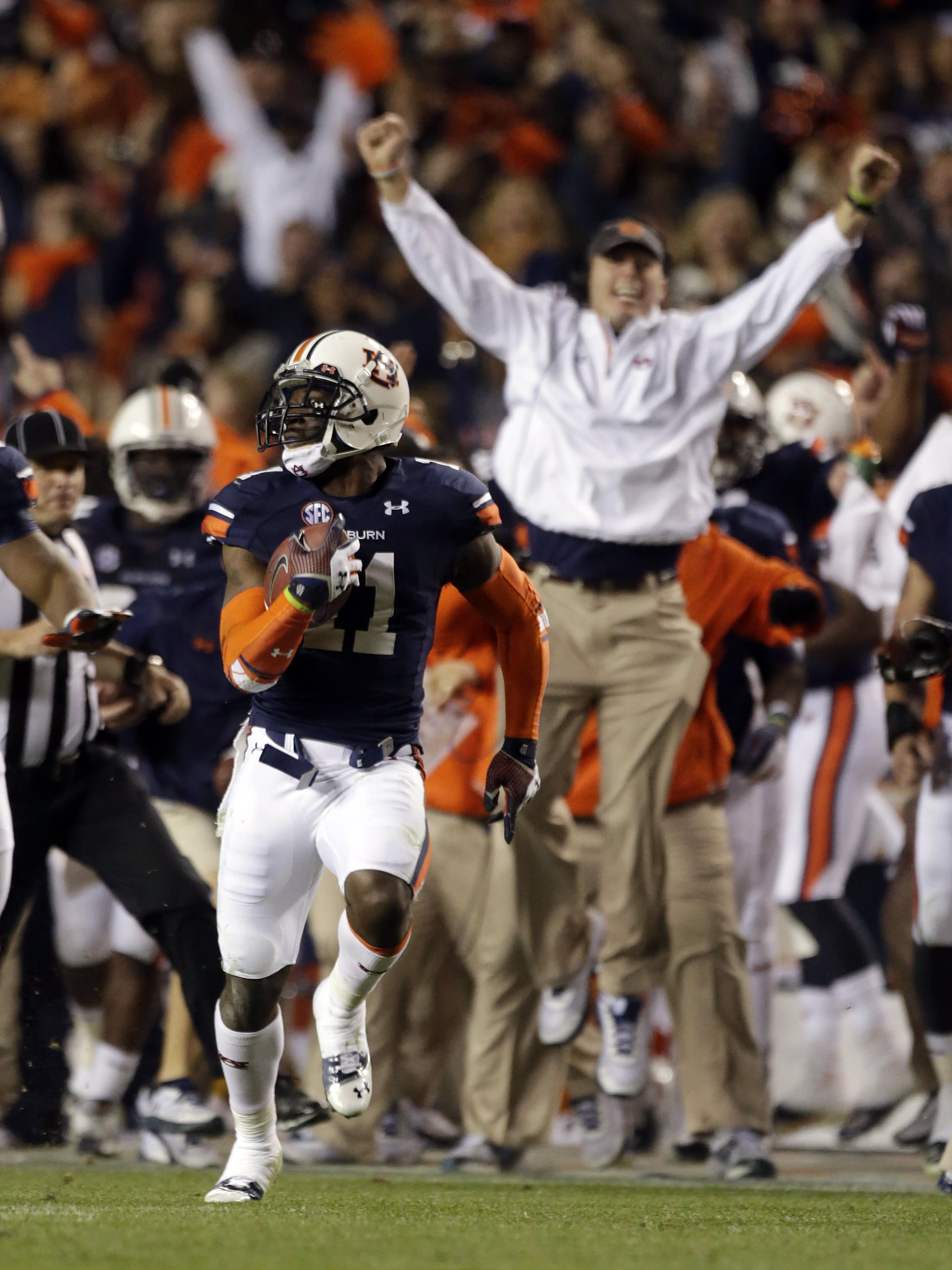 Auburn cornerback Chris Davis (11) returns a missed field goal attempt 100-plus yards to score the game-winning touchdown as time expired in the fourth quarter of an NCAA college football game against No. 1 Alabama in Auburn, Ala., Saturday, Nov. 30, 2013. Auburn won 34-28. (AP Photo/Dave Martin)