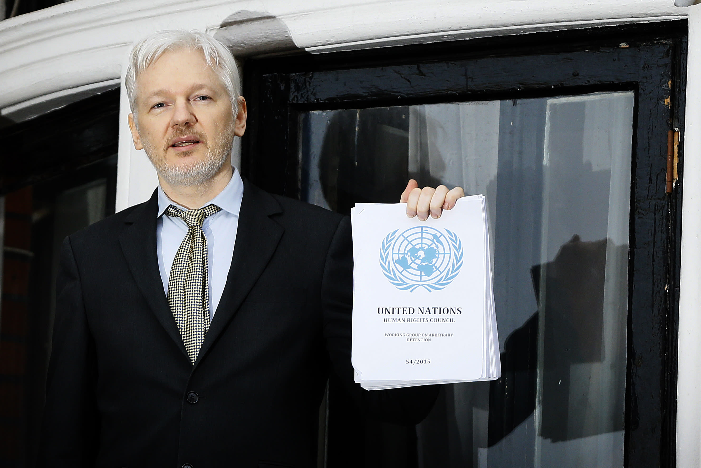 """FILE - In this Feb. 5, 2016, file photo WikiLeaks founder Julian Assange speaks on the balcony of the Ecuadorean Embassy in London. President Barack Obama's decision to commute Chelsea Manning's sentence quickly brought fresh attention to another figure involved in the Army leaker's case: Julian Assange. In a tweet in early January 2017, Assange's anti-secrecy site WikiLeaks wrote, """"If Obama grants Manning clemency Assange will agree to US extradition despite clear unconstitutionality of DoJ case."""" (AP Photo/Kirsty Wigglesworth, File)"""