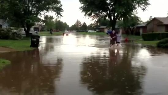 Raw Video: Moore couple wades through flood water