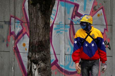 A demonstrator looks on while clashing with riot security forces during a rally against Venezuela's President Nicolas Maduro's government in Caracas, Venezuela, July 28, 2017. REUTERS/Carlos Garcia Rawlins