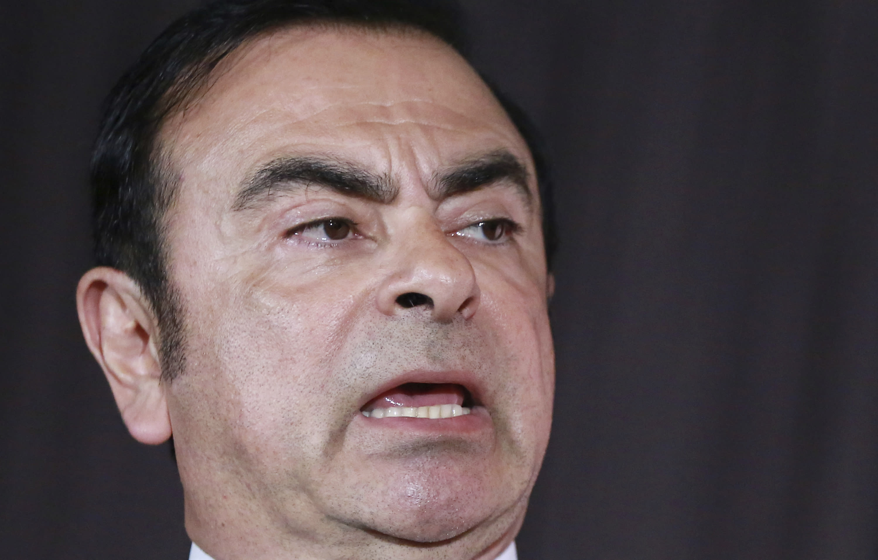In this May 12, 2016, photo, then Nissan Motor Co. President and CEO Carlos Ghosn speaks during the press conference in Yokohama, near Tokyo. The children of former Nissan chairman Carlos Ghosn, who is under arrest in Tokyo, have defended their father's love for Japan and denounced comments by the Japanese automaker's chief executive. The statement from Caroline, Nadine, Maya and Anthony Ghosn, seen Monday, March 4, 2019 by The Associated Press, says Ghosn had affection and respect for Japan and Nissan Motor Co. (AP Photo/Eugene Hoshiko)