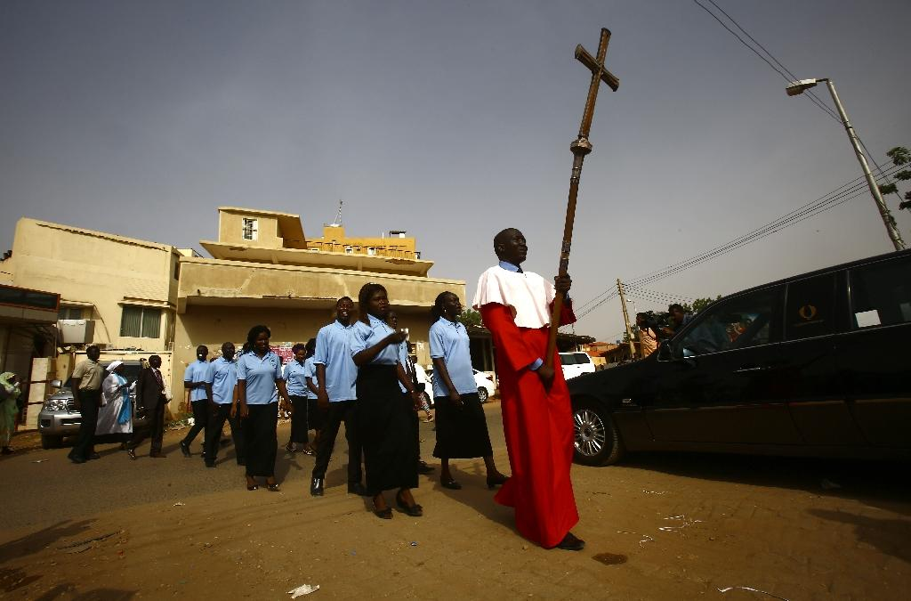 Sudanese Christians at a ceremony led by the Archbishop of Canterbury at Khartoum's All Saints Cathedral on July 30, 2017 (AFP Photo/ASHRAF SHAZLY)