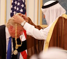 Donald Trump appears to 'curtsey' to Saudi king after mocking Barack Obama for bowing
