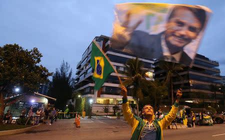 A supporter of Brazilian presidential candidate Jair Bolsonaro is seen in front of Bolsonaro's condominium at Barra da Tijuca neighborhood in Rio de Janeiro, Brazil October 5, 2018. REUTERS/Sergio Moraes