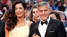 Amal Clooney wears strapless, striped jumpsuit on date night with George