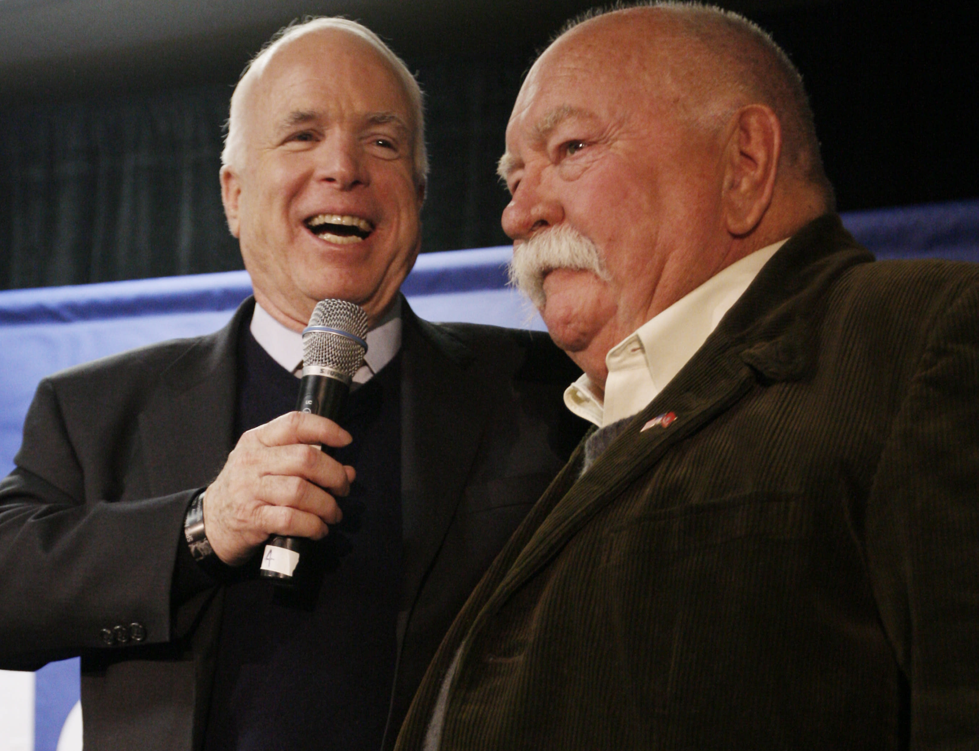 "FILE - In this Jan. 4, 2008, file photo, Republican presidential hopeful, Sen. John McCain, R-Ariz., left, introduces actor, Wilford Brimley, after making a reference to fellow Republican presidential hopeful, former Arkansas Gov. Mike Huckabee, campaigning with actor Chuck Norris, as McCain makes a campaign stop at Hudson Veterans of Foreign Wars Post 5791, in Hudson, N.H. Brimley, who worked his way up from stunt performer to star of film such as ""Cocoon"" and ""The Natural,"" has died. He was 85. Brimley's manager Lynda Bensky said the actor died Saturday morning, Aug. 1, 2020 in a Utah hospital. (AP Photo/Charles Dharapak, File)"